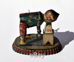 1915 Issmayer Distler German Wind-up Tin Toy Strongman RED Base 1 of 1 Known