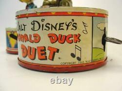 1945 Louis Marx Co. Walt Disney Donald Duck Duet Tin Wind Up Jigger Toy Goofy