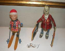 2 Vintage Tin Toys- Occupied Japan Tin Wind Up Skier+suitcase Man-both Work