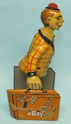 ANTIQUE 1920's DISTLER GERMAN TRAVELING CLOWN BAGGAGE HANDLER TIN WINDUP TOY