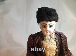 Antique French F. G. Wind Up Mechanical Doll riding Tricycle