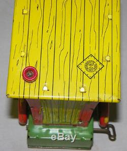 Antique Tin Wind Up Humphrey Mobile Toy by Wyandotte Toys