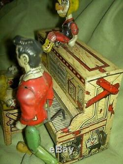 Antique, Unique Art Mfg. Co. Li'l Abner Dogpatch Band tin working wind-up toy