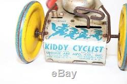 Antique Vintage Tin Litho Windup Toy Unique Art MFG Kiddie Cyclist on Tricycle