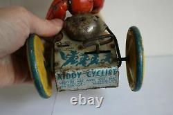 Antique Vtg UNIQUE ART KIDDY CYCLIST BOY IN TRICYCLE Wind Up Tin Litho Toy