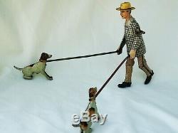 Lehmann no. 724 Snik Snak''Man with two Dogs'' Tin Toy Very Rare