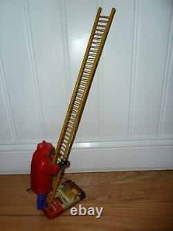 Louis Marx & Co. Smokey Joe climbing firefighter vintage wind up tin toy