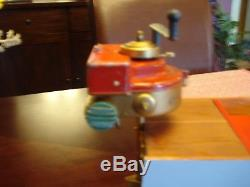 Orkin craft outboard with boat and stand bing, carette windup working vintage toy