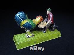 Pre-war Japan 7 ¼ Vintage Tin Mechanical Wind-up Boy Feeding Chicken Toyodo