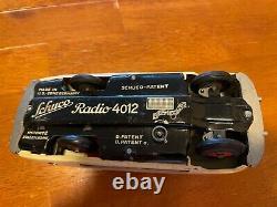 Schuco Tin radio car 4012
