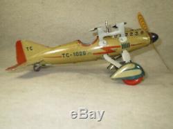 Tippco Tipp & Co clockwork airplane drops 4 2-piece cap bombs, box, pilot, works