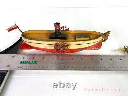 Uebelacker ca. 1900 Paddlewheeler Windup Tin Boat with Figurehead