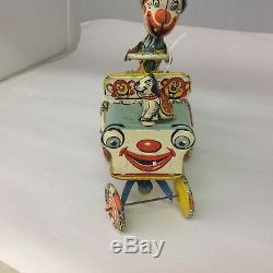 VINTAGE UNIQUE ART MFG. CO. ARTIE THE CLOWN Tin Wind Up Toy Car. 591-G