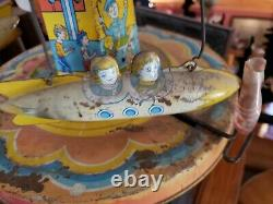 Vintage 1952 Chein RIDE A ROCKET Tin Litho Wind-up Toy