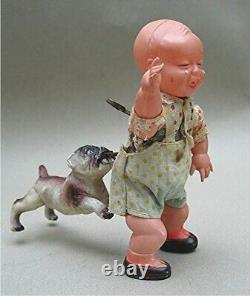 Vintage Celluloid Boy with Bull Dog bitting his behind Wind up Made in Japan