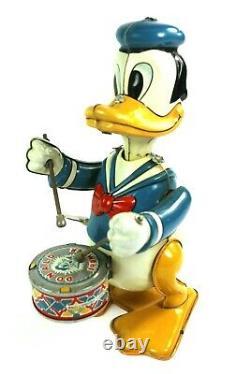 Vintage Donald Duck Mech. Drummer Rocker Tin Wind Up Walt Disney Productions