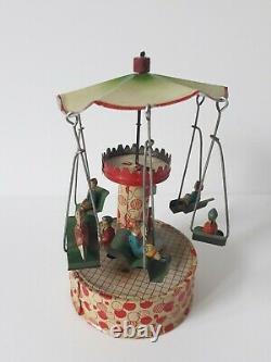 Vintage Gunthermann, Bing, Distler Windup tin carousel swings toy, Germany-SUPERB