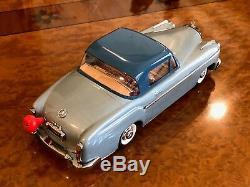Vintage Schuco Rollfix 1085 Mercedes-Benz 220 SE Momentum Drive Tin Toy
