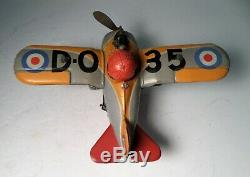 Vintage Tin Japan Plane Wind Up D-O 35 Fire Sparkle Litho Fighter Airplane Toy