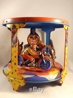 Vintage Tin toy wind-up motorbike bike horses carousel riding arena clown Italy