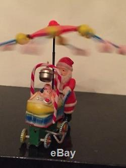 Vintage Toy Santa Claus Celluloid Tin Litho Wind Up Spinning Umbrella Baby Buggy