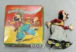 Vintage Wind Up Clown On Roller Skates In Original Box