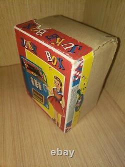 Vintage tin toy wind up Juke Box Haji Japan in original box working great clean