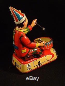 Vintage tin toy wind-up clown circus bump car drum HWN Nuremberg W. Germany 1950s