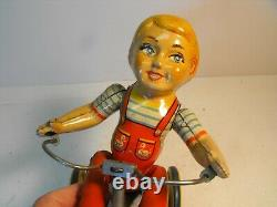 Vintage tin wind-up UNIQUE ART Mfg Co. Kiddy Cyclist, complete & works